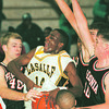 97/12/03--PAL HOOPS/LASALLE--DAN CAPPELLAZZO PHOTO--LASALLE SR. CASTON BINGER BATTLES 3 FERDONIA HILLBILLIES UNDER THE NET IN 1ST HALF ACTION.<br /> <br /> SP