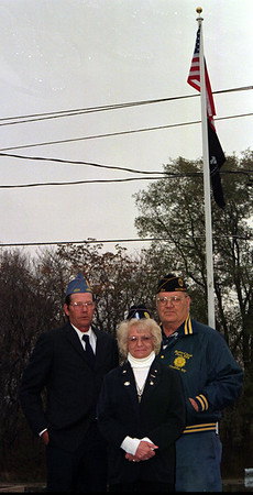 98/11/09 Flag donate-Rachel Naber Photo-(clockwise) June Dunn, Jim Parsons, John Hydock in front of flag atAmerican Legion.  Refer to JOHN for correct information.