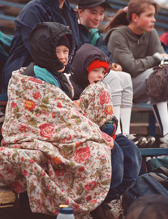 4/29/97-- in blanket--Takaaki Iwabu photo-- Matthew and Eric Tower, 8 and 6-year-old brothers of Youngstown, share a blanket as they brave the Thursday's windy weather to watch the soft ball game in Academy Park in Lewiston. <br /> <br /> grapevine photo