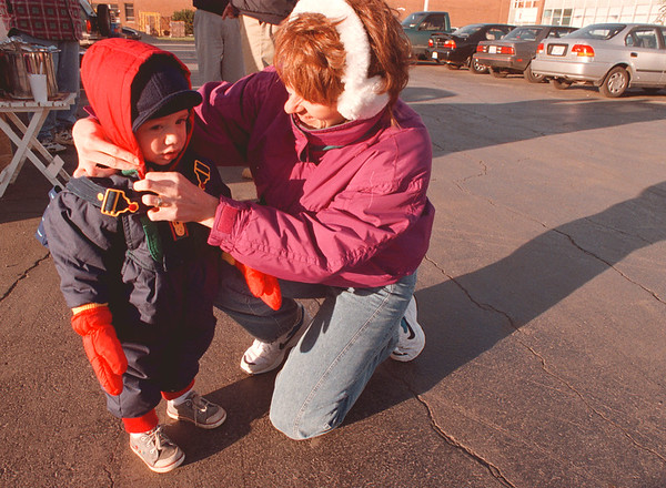 10/20/97-- cold weather --Takaaki Iwabu photo-- A 21-month-old Gabe Werner bundles up with a help of his mother Cindy Werner at Niagara Catholic High School Monday. The two were visiting a football game. <br /> <br /> local, Tuesday, bw