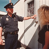97/09/18-- safety tip --Takaaki Iwabu photo-- Sgt. W. Ross Annable of Niagara County Sheriff gives a safety tip to trailer-home residents in Cayuga Village Thursday. <br /> <br /> 1A, Friday