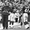 9/22/96--KELLY--CAppy photo--a sidelined jim kelly gives darrick holmes support after a long run.