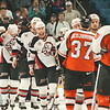 5/11/97--SABRES/HAND SHAKE--DAN CAPPELLAZZO PHOTO--A DEJECTED MICHAEL PECA (CENTER) LINES UP WITH TEAMMATES TO SHAKE HANDS WITH FLYERS AFTER A 6-3 DEFEAT PUT THEM OUT OF THE PLAYOFFS.<br /> <br /> 1A