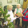 98/12/07 dale/cookie walk--dan cappellazo photo--(LTOR)Dale assoc. vol. Marce Eichinger, Gramma mike maslowski and roberta snyder prepare for the annual cookie walk.