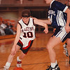 2/25/97-- falcons 1--Takaaki Iwabu photo -- NW's gurd Kim Hoyt beats Hamburg defense Courtney Snowberger. <br /> <br /> sports
