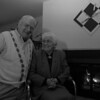 1/20/97--LONGIN PHOTO FOLKS--CAPPY PHOTO--PAUL AND LIA LONGIN SIT INFRONT OF THIER FIREPLACE IN THEIR RIVER RD HOME. OVER THE FIREPLACE IN A 5OTH YR ANNIVERASY SWORD WORD IN THE POLISH AIRFORCE. LONGING WAS IN THE AIRFORCE IN 1938.<br /> <br /> WED FEATRUE