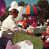 97/09/27 Family Fun Fest--Takaaki Iwabu  photo-- Rosemary Dann, a teacher at Maple Avenue School, gives away a baloon to Sam Cale, 6, during Family Fun Festival at Maple Ave. School Saturday. (The first year event featured pony ride, face painting, chickedn BBQ etc....) <br /> <br /> Grapevine photo