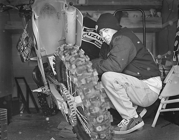 1/23/97-- pro rider-- Takaaki Iwabu photo--  A motorbike racer Monte Frank works on his bike in the trailor which he  parked near Niagara Falls Convention Center Thursday. A pro racer from Oklahoma City competes in PJI AMA Arenacross Motorcross at Convention Center this weekend. <br /> <br /> Grapevine photo