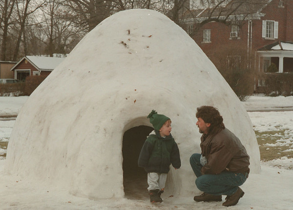 98/01/23-- Igloo--Takaaki Iwabu photo-- Anthony Szeliga of 908 College Ave. made his original igloo in front of his house for his 2-year-old son, Anthony Jr., picture left. The two were playing together Sunday afternoon. <br /> <br /> grapevine photo