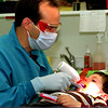 98/11/06 Funny Tools *Dennis Stierer Photo -<br /> Dr. Louis A. Surace, a pediatric dentist in Lockport, not only has a great atmosphere to work in, but also uses colorful tools and eyewear.