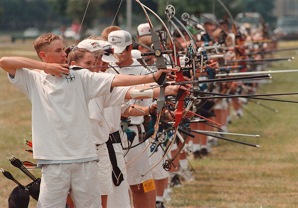 8/1/97 archery --Takaaki Iwabu photo-- Christian Yanchula, left, and other participants of PAL archery contest line up at Niagara University Saturday. Yanchula is from Armada, Michigan. (No local kid was in archery contest) <br /> <br /> Sports, Sunday, BW