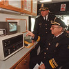 5/27/97 Cops & Cameras  - James Neiss Photo - Dep. Suprintendent Ernest Palmer and Superintendent Anthony Fera visited the Niagara Falls Police Mobile Command Unite to view activities at the corner of Pierce and 13th from a video servalience camera mounted on a telephone pole to monitor drug activities at the corner.