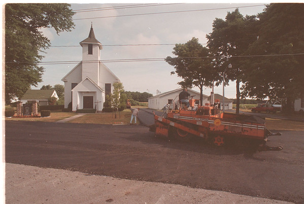 97/08/12 County Pavers 2 - James Neiss Photo - County equipment is used to pave the parking lot of St. Andrews Lutheran Church on Upper Mountain Rd. in Sanborn.