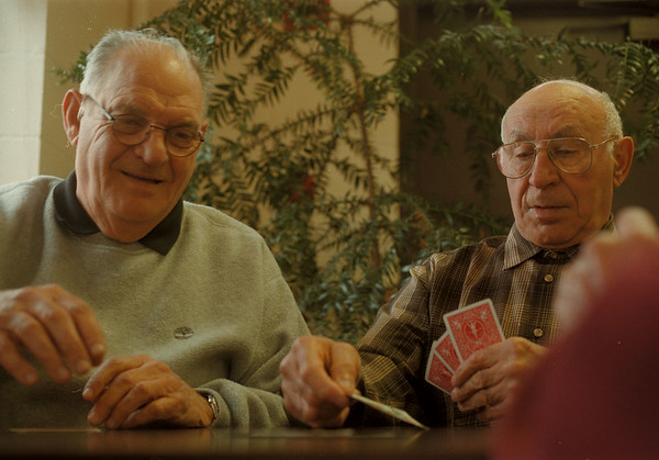98/04/17-- card game--Takaaki Iwabu photo-- Jose Pena, left, and Tom Minervino, both from Niagara Falls, play a card game with their friends at Duke John A. Senior Citizens Center on Hyde Park Blvd. Friday. Local senior citizens get together twice a week to play a card at Center. <br /> <br /> grapevine photo