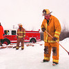 1/27/97--ICE RINK--DAN CAPPELLAZZO PHOTO--UPPER MTN. VOLUNTEER FIREFIGHTER EDWARD WEBBER CLEARS OFF THE ICE AS FELLOW FIREFIGHTERS (LTOR) CHARLIE KRAFT, CARL HILLMAN AND DAVE ORSI LOOK ON  AT LUTHERAN CHURCH ON UPPER MTN. ROAD.<br /> <br /> ECHO-MIRROR