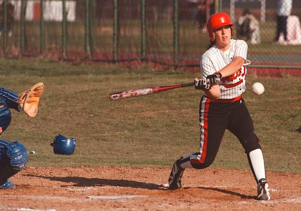 4/15/97-- NW softball 1--takaaki iwabu photo-- Christine Hinderliter hits a triple..........