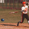 4/15/97-- NW softball 1--takaaki iwabu photo-- Christine Hinderliter hits a triple..........