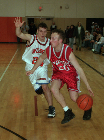 98/02/18 Stpt@Wilson2 - James Neiss Photo - Wilson # 24 Greg Bradley puts the pressure on Starpoint # 50 Ryan Murphy durring the 1st period.