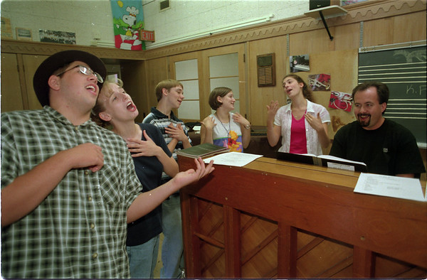 98/08/04 Play Rehursal - James Neiss Photo - Lockport HS  Bye Bye Birdie (sp?) cast members Practice for August 15th &16th Performance. L-R are, Corey Penna as Mr. MacAfee, Elizabeth Wills as Mae, Matt George as Albert Peterson, Ericka Milczarski as Rosie and Jenn D'Agostino as Kim MacAfee. At far Right, Lawrence Timm, Director of the play and Vocal Instructor at Lockport High, accompanies on the piano.