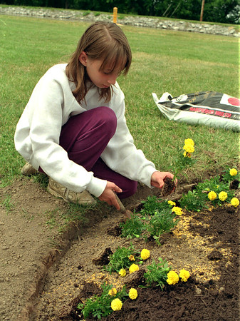98/06/05 Planting Time *Dennis Stierer Photo - Erica Maines, a fourth grader at Gasport Elementary School spent some time recently planting flowers around the flagpole at Gasport Park.<br /> SEE WRITE UP FROM REGINA BROWN.