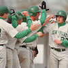 5/23/97-- Lancers 1--Takaaki Iwabu photo-- Lew-Port HS players meet Pete Nastasi at home base after he hits three-run homerun during Friday's play-off game against Albion HS. <br /> <br /> sports, Saturday