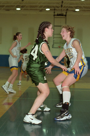 98/02/21 Guard Me *Dennis Stierer photo - #24 Amy Comer of Shenendehowa gets a mouthful from #55 Heather Campbell of Lockport.