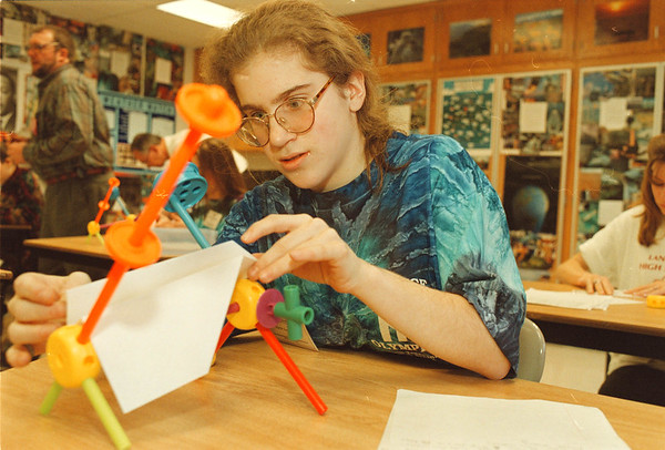 "3/1/97-- science compt.-- Takaaki Iwabu photo--  Jenny Miller, 10th grader of North Tonawanda, contemplates on the question she and other students got at ""Write It & Do it"" during the science comptetion at N-T HS Saturday."