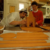98/12/02 Gingerbread 2 - James Neiss Photo -  Ernest Ramstetter, co owner of Muscoreils Fine Desserts and Gail Sprenger, owner of Galassi Sub Shop both decide how a gingerbread house will be put together.