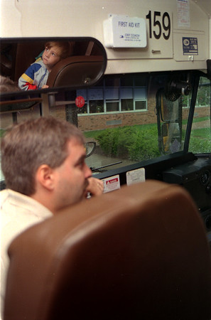 98/09/02 First Bus-Rachel Naber Photo- Garrett Smith, 5(top) checks out the school bus he will be riding the first day of kindergarten as Brian Foeller answers his mothers questions about th route to and from Albion Elementary School.