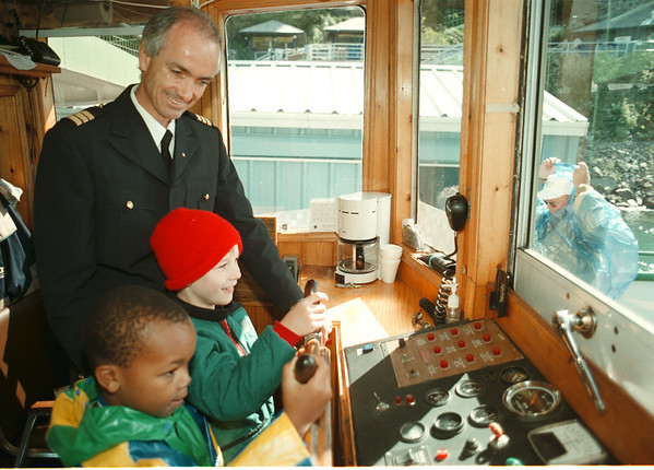 98/10/01 Maid Visit - James Neiss Photo - Students from the Maple Ave. School go for ride on Maid of the Mist. Here, L-R 1st mate John Williams show Bill Gee 5yrs and Thomas Pryor 6yrs, both in 1st grade, the wheel house of the Maid of the Mist IV before beginning the ride.