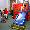 98/06/03 Y Kids2-Rachel Naber Photo-Megan Costich (left) checks out the toys available at the new Kids R Special along with her sister Katlin (right) preschool to the delight of family center worker Jean Tranello.