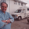 "3/11/97 Mobile Veterinary Clinic - James Neiss Photo - Companion Animal Mobile Veterinary Clinic, Karl G. Baker, D.V.M. and dog ""Suki""."