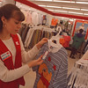 3/16/97--TAX CUTS/CLOTHES--DAN CAPPELLAZZO PHOTO--KMART WOMANS' CLOTHING CLERK KRISTIN O'LAUGHLIN CHECKS THE TAG ON A GARMENT IN THE WOMANS DEPT. OF THE MILITARY RD. STORE.