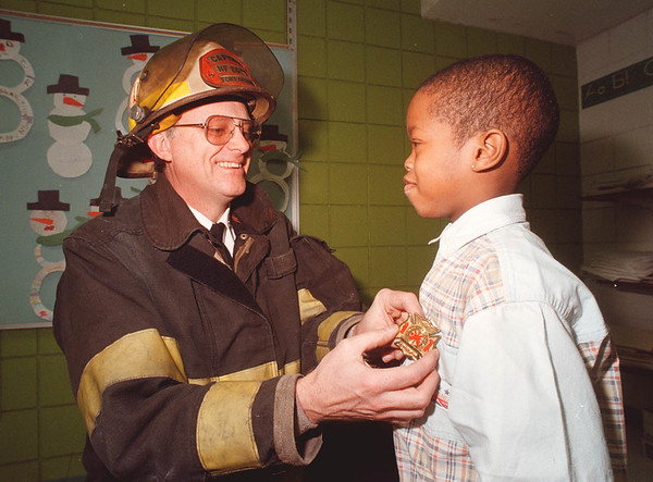1/29/96 Junior Fire Fighter - James Neiss Photo - 6yr old James Robinson became a Junior Fire Fighter today along with the rest of his 1st grade class at the Abate Elementary School presendted by Niagara Falls Fire kCapt. of Investigation Miles Gebauer.
