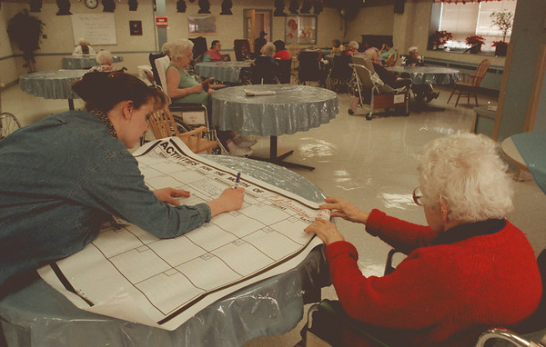 98/01/29--ACTIVITIES--DAN CAPPELLAZZO PHOTO--MOUNT ST. MARY'S NURSING HOME ACTIVITIES ASSISTANT HEATHER ALCORN AND RESIDENT MARY SIUTA, 85-YR-OLD, PLAN THE MONTHLY SCHEDULE AT THE MAIN STREET NURSING HOME.<br /> <br /> GR