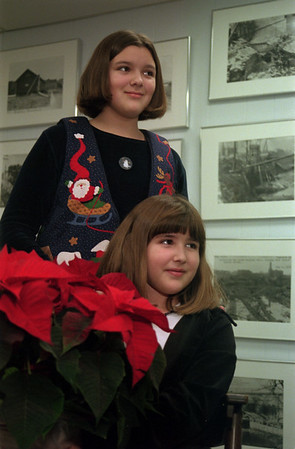 98/12/10 Historic Winner-Rachel naber Photo-Anne Robinson, 11(top) and her sister Megan, 8 recieved a pointsetta winning the Christmas trivia contest at the Medina Historcial Society.