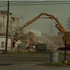 98/05/27 Out with Old - James Neiss Photo - Demolition crews tear down some of the old buildings at the Treibacher Schleifmittel Corp. compound at 2000 Colege Ave. They said this was an ongoing project to remove some of the 1848 era eye sore, get the unused building off the tax role and to make room for future expansion. 286-1234