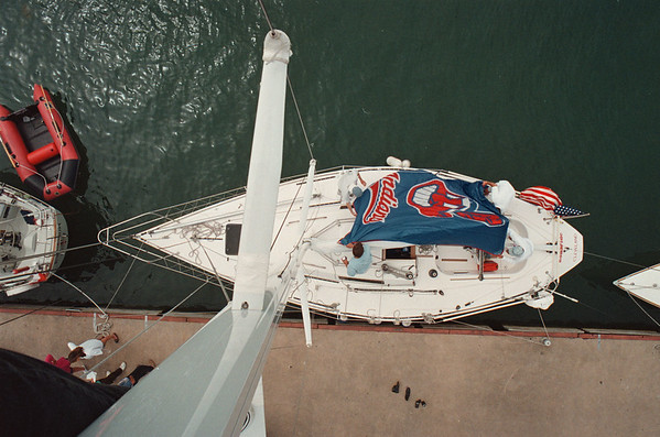 """7/24/97--LEVEL REGATTA--DAN CAPPELLAZZO PHOTO--THE CREW OF BONAFIDE, (BOTTOM LEFT CLOCKWISE) REVERE SEARLES, DAVID KROTSENG, ROLK """"CRUNCH"""" KROTSENG AND CHAD ATZEMIS UNFURL A CLEVELAND INDIANDS FLAGA IS AN OVER HEAD VIEW OF THE J-34 YATCH """"BONAFIDE,"""" FROM CLEVELAND.<br /> <br /> 1A"""