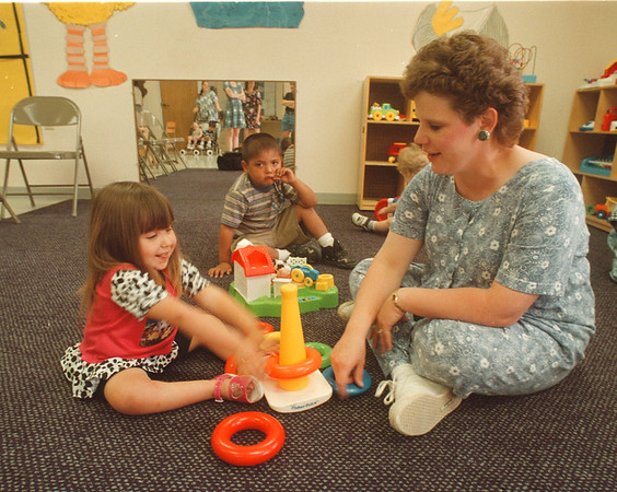 6/12/97 Cerebral Palsy Center - James Neiss Photo - United Cerebral Palsy of Niagara County special education teacher Sue Nadeau works with students Vienna Armeli 3yrs and Maxwell Antone 3yrs.