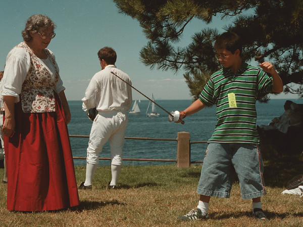98/08/01- Old Fort --Takaaki Iwabu photo-- Michael Keena of Riverhead, N.Y., learns how to use a sword from re-enactor Barbara Fudge, left. The 18th Century Fair, a new event at Old Fort Niagara, drew a crowd Saturday. The Fair will continue today.