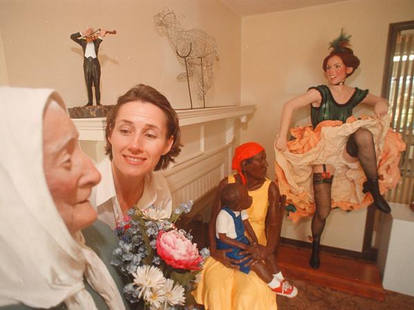 97/09/22 Sculptor - James Neiss Photo - Lewiston Artist Susan J. Geissler shows off  a few of her sculptures.
