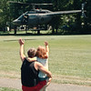 7/12/97--DARE-A -PALOOZA--DAN CAPPELLAZZO PHOTO--TOM PROHN, OF SANBORN, AND HIS 6-YR-OLD DAUGHTER CASEY WAVE TO THE NIAGARA COUNTY SHERRIFFS CHOPPER TAKES OFF FROM THE SANBORN FIRE HALL DURING THE DARE FESTIVAL.<br /> <br /> 1A NEWS