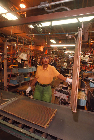 2/18/97 Delphi Harrison - James Neiss Photo - Delphi Harrison Thermal Systems is diversifying its customer base. Here, Wanda Lewis of Niagara Falls, A Assembly line worker,  put's together Condenser Cores for air conditioners.