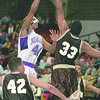 1/2/97--HOOPS--CAPPY PHOTO--N.U.'S  KEVIN JOBITY,SPORTING A NOSE GUARD, GOES HIGH OVER LEHIGH'S DAMIEN McGILL AS LEHIGH'S BRYCE FORT(42) WAITS FOR A REBOUND.<br /> <br /> SP