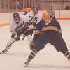 2/18/97 NU VS Canisius Hockey - James Neiss Photo - NU #3 Chris MacKenzie tries to drive the puck around Canisius #2 Jon Braun in the first period.<br /> <br /> Niagara University Hockey