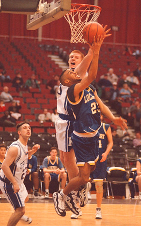 2/27/97--SECT 6/HOOPS--DAN CAPPELLAZZO PHOTO--LOCKPORT'S TROY HODGE PUTS IN A LAYUP AGAINST FRONTIER'S JOSH BECKER IN 2ND HALF ACTION.<br /> <br /> SP
