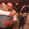 6/23/97--PAGE BENEFIT 2--DAN CAPPELLAZZO PHOTO--DARLENE ADAMS,  OF N.F. GIVES JAMES PAGE A HUG AS JoANN MASSARO, N.F., GIVES PATTIE PAGE A HUG AT THE PAGE BENEFIT AT DANTE'S.<br /> <br /> 1A TUES