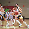 98/03/03 Lockport Wins *Dennis Stierer photo - Jamie Kudel #23 takes a fast break.