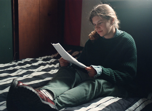 5/12/97-- letter from home--Takaaki Iwabu photo-- Irena Kralova, student at Niagara County Community College, reads a letter from her parents at her apartment in Niagara Falls. Kralova, navive of Czeck Republic, is one of the 900 students who will receive diplomas from NCCC at the graduation ceremony at the end of this month. She will return to her home during this summer. <br /> <br /> grapevine photo<br /> <br /> grapevine photo