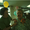 98/05/13 100 yrs Old - James Neiss Photo - Beatrice Dineen of NF pins flowers on her mother Catherine Stables who just turned 100 yrs old. A party in her honor was held at Wrobel Towers where she lives.